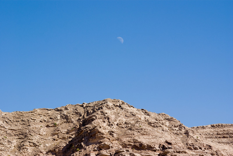 Capturing the moon at high noon on the summit of Jebel Hafit, UAE.
