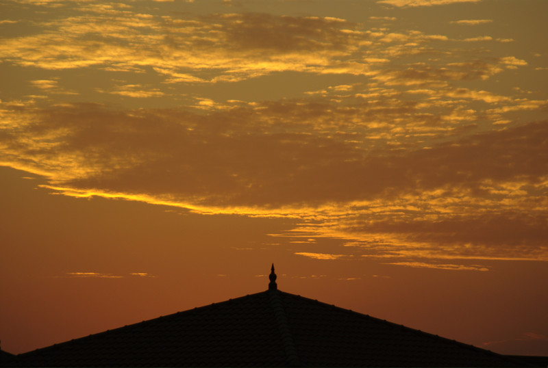 I was just messing around on the roof of my office, trying to capture yet another sunset. The spire forms the point of the office buildings in my office complex.