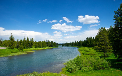 Blue waters of the Buffalo River in Idaho flows out of Yellowstone National Park.