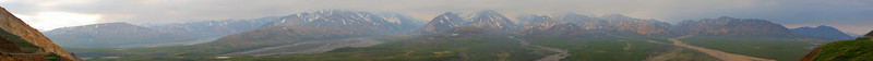 This was my first experiment with building a panorama.  This is Polychrome Mountain in Denali Park in south-central Alaska.<br /> <br /> I used an 85 mm lens on my Canon 20D.  Used manual exposure (exposed for highlights) and focus at infinity.  I held the camera horizontally (landscape).  This was all hand held; the closest points (extreme left and right of the frame) were over 1000' away and most of it was miles away, so any positioning error was minimal.  When I optimized with Hugin I had worst case errors of well under 1 pixel -- completely insignificant.<br /> <br /> I've done very little post-processing -- just a bit of curve tweaking, some saturation boost, and a light unsharp mask.<br /> <br /> In retrospect, I should have used a shorter lens (perhaps 50 mm) and held the camera vertically.  The strip is simply too narrow to be very good, although the detail is incredible.  I was pressed for time (our tour bus wasn't stopping for very long) and didn't plan out what I wanted to do.  My 50 mm lens is plenty sharp itself.  Using a monopod would also help, not so much to avoid positioning error (which would be more of an issue with the 50 mm lens since I'd have more foreground) as to ensure each photo was taken from the same vertical angle (to permit me to use as much of the shot as possible).<br /> <br /> My other technique of shooting with two focal lengths might also have been helpful, although less so than with my other panorama, which had less foreground detail to begin with (and where that foreground wasn't in focus anyway, and mostly served to frame the image).