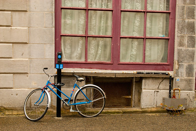 Blue Bike By Red Window