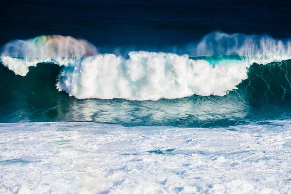 Rainbow in a wave off Hookipa, Maui, Hawaii.