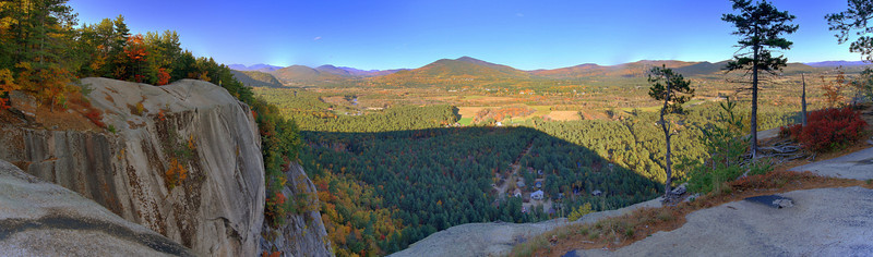 Exposure fused pano from Cathedral Ledge near North Conway, NH.  I hiked up, but it's better known for rock climbing; there's also an auto road.  Dynamic range was a real problem in late afternoon, but with 3 exposures 2 stops apart there was enough to get good tonality.  Full size is about 40 megapixels.