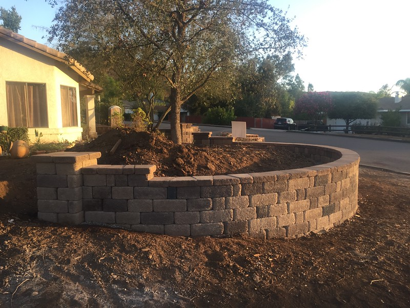 It makes a huge difference to have some hardscape in place on the corner lot.