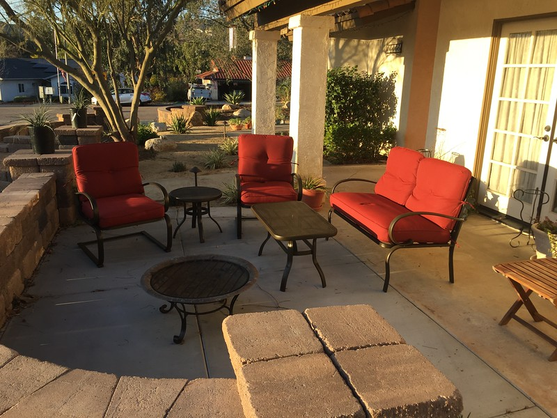 I spent a morning assembling this new patio furniture for the front of the house.