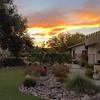 Enjoying a summer sunset in our backyard.