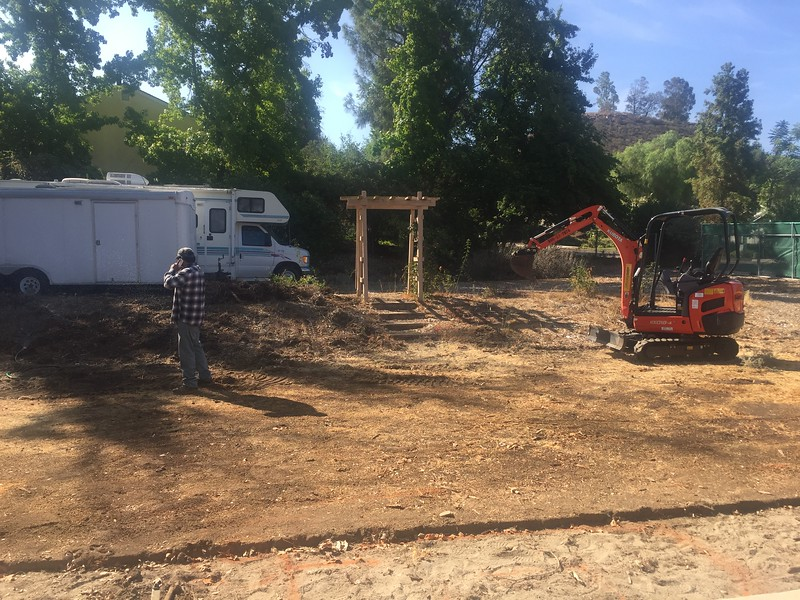 The machine was able to scrap down and push all of the dirt up the level to make room for the new dry creek bed.