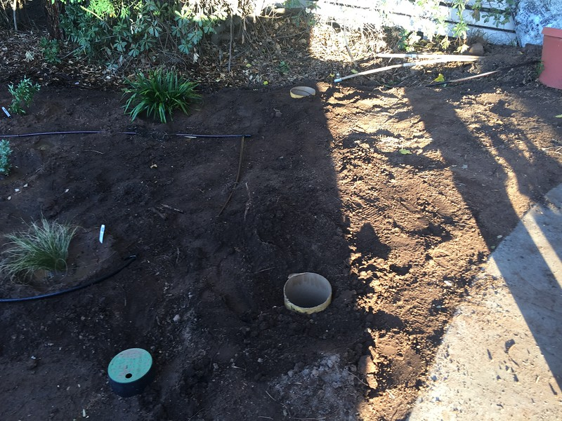 We also drilled down two post holes for some fencing. This will be a small fence just to hide the trash cans behind. I picked up some bags of concrete to fill the holes and set the post anchors.