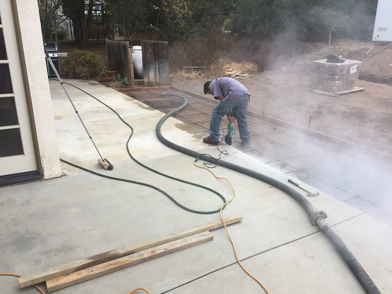 Some last minute touch up of the old slab where the previous patio post was located.