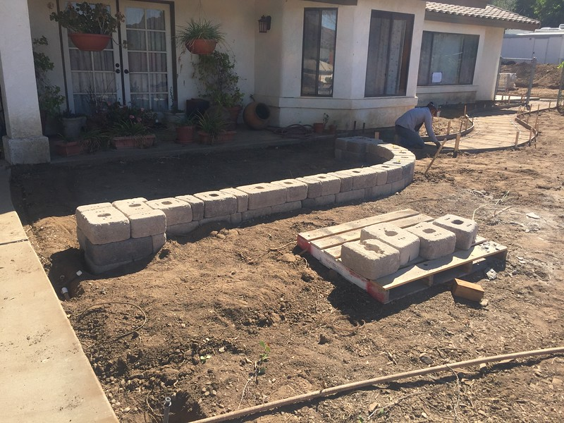 Getting ready for the concrete pour. The sidewalk and patio get leveled out and defined.