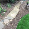 I borrowed Alex's truck again and got some more DG to fill in under and around these flagstone pieces. I was just about 3 feet from completion when I ran out and had to go get another load. The Wooly Thyme got planted in between the pathway and the artificial turf.