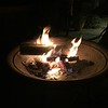 We spent a long day planting and finishing up the yard in front, so tonight we put some wood in the fire pit and had a campfire on the front patio. Weather was beautiful. We had a bit of wine and some pizza to relax.