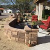 The firepit and furniture on the front patio. We got more planters for the front that sit up on the wall ends.