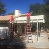 Adding the lattice to the patio. What a difference some shade makes back here.