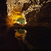 Cueva de los Verdes: Throw a rock down the hole and listen to the sound of the cave.