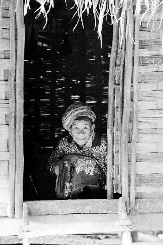 old lady crouching in doorway