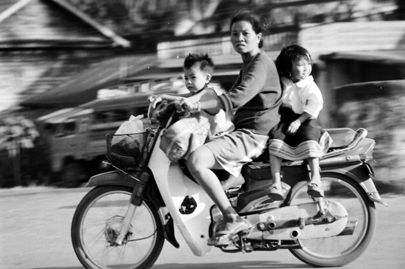 mother and children on motorbike