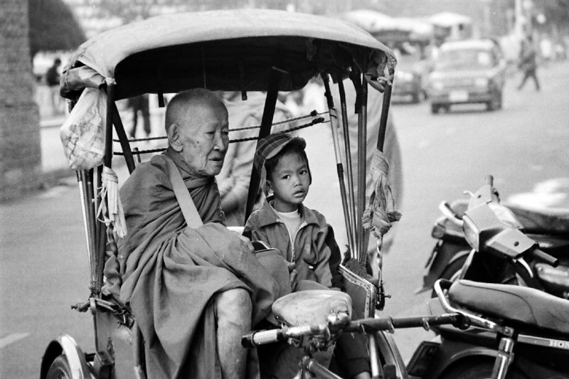 monk with child on rickshaw 2