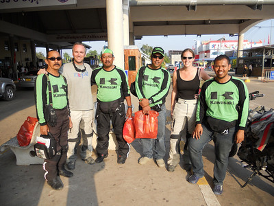 It's no-mans' land so that must mean we bump into four Malaysian bikers on Kawasakis!