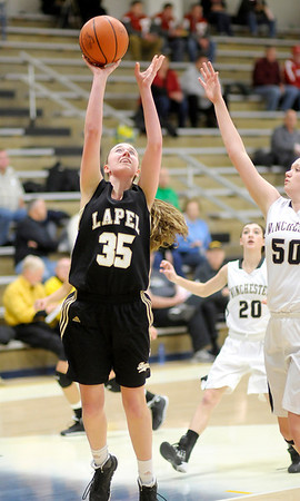 Don Knight / The Herald Bulletin<br /> Lapel's Mary Jewel Stohler shoots a layup as the Bulldogs faced Winchester in sectional action at Shenandoah High School on Tuesday.