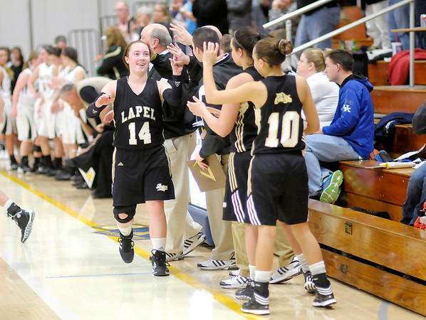 Don Knight / The Herald Bulletin<br /> Lapel's Kirsten Rich gets high fives from her teammates as Coach Kevin Brattain pulls his starters with a commanding lead in the final seconds of the Bulldogs sectional matchup against Winchester at Shenandoah High School on Tuesday.