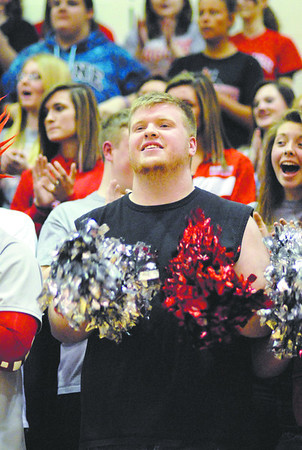 A Frankton High School student waves pom poms during the introduction of players.