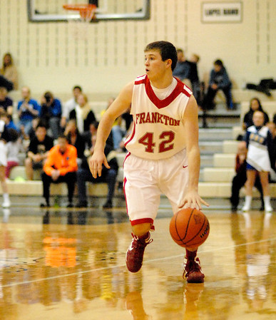 Bailey Threet brings the ball downcourt for the Eagles.