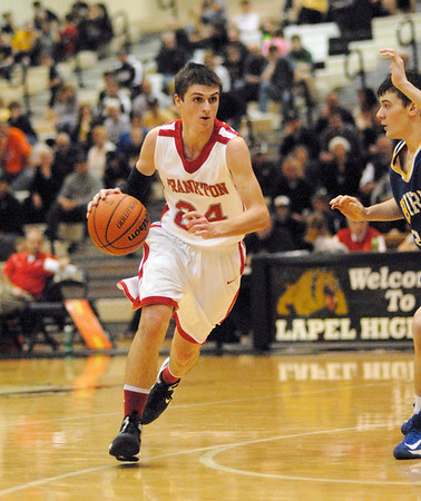 Frankton Eagle Trevor Hughes drives toward the basket.