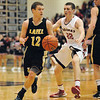 Lapel senior Tanner Watkins brings the ball downcourt during the closing minutes of the game.