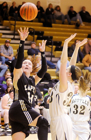 Don Knight / The Herald Bulletin<br /> Lapel's Kirsten Rich shoots as she is guarded by Madison-Grant's Mallorie Havens on Wednesday.