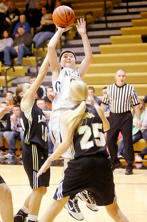 Don Knight / The Herald Bulletin<br /> Madison-Grant's Meagan Mooney shoots as the Argylls hosted the Lapel Bulldogs on Wednesday.