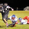 Don Knight/The Herald Bulletin<br /> Lapel's Joe Hart breaks several tackles as the Bulldogs hosted the Elwood Panthers in the first round of sectional action on Friday.