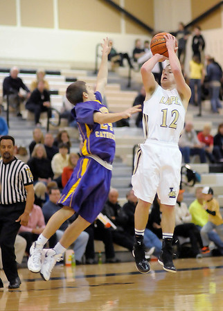Lapel's Tanner Watkins shoots as he is guarded by Guerin Catholic's Tayler Vickery as the Bulldogs hosted the Golden Eagles on Saturday.