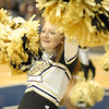 Lapel cheerleader leads a cheer while the pep band plays.
