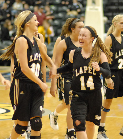 Kirsten Rich is all smiles as she walks off the court with teammate Mackenzie Boles after Lapel defeated Cardinal Ritter at the Hoosier Invitational held Saturday at Bankers Life Fieldhouse in Indianapolis.
