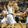 Lapel junior Kaitlin Dobbs finds herself surrounded by Cardinal Ritter players during third quarter action of the game.