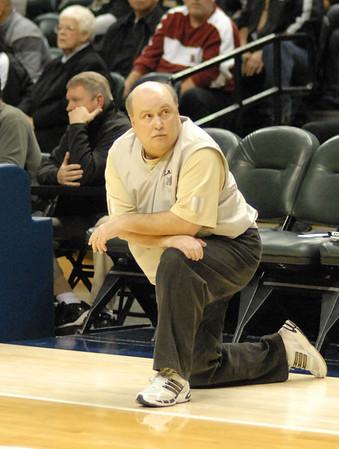 Lapel head coach Kevin Brattain watches the clock during the final minutes of the game.