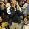 Lapel basketball fan Kevin Guion claps his hands during a break in the game.
