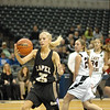 Kaitlin Dobbs saves the ball from going out of bounds beneath the Lady Bulldogs basket.
