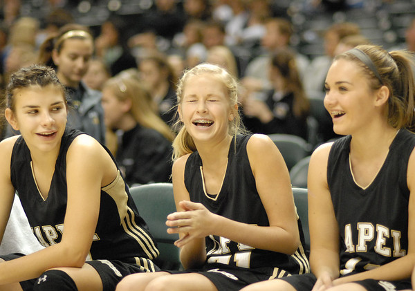 Players on the Lapel bench enjoy a laugh during the game.