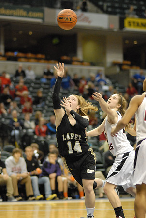 Kirsten Rich gets fouled while driving toward the basket.