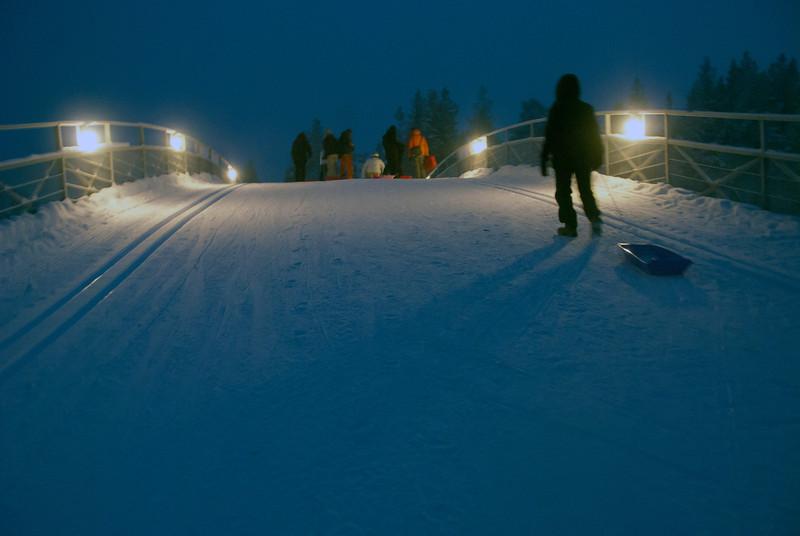 Climbing the 1.2 kilometer Kaunispää toboggan slope, Finnish Lapland.