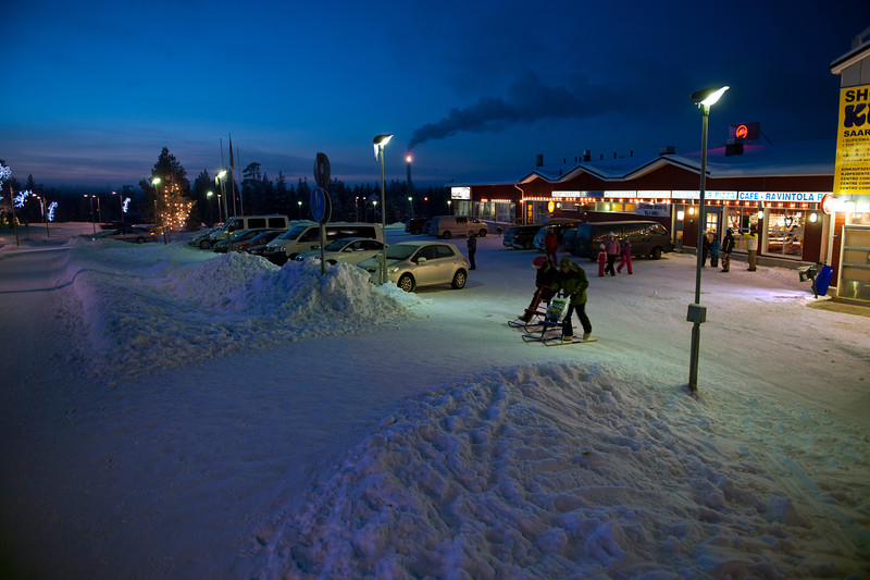 Main (just about only) shopping area in the resort town of Saariselkä, Finnish Lapland. Those two customers are using a Finnish means of transportation called a potkuri, a kind of a sled thing.