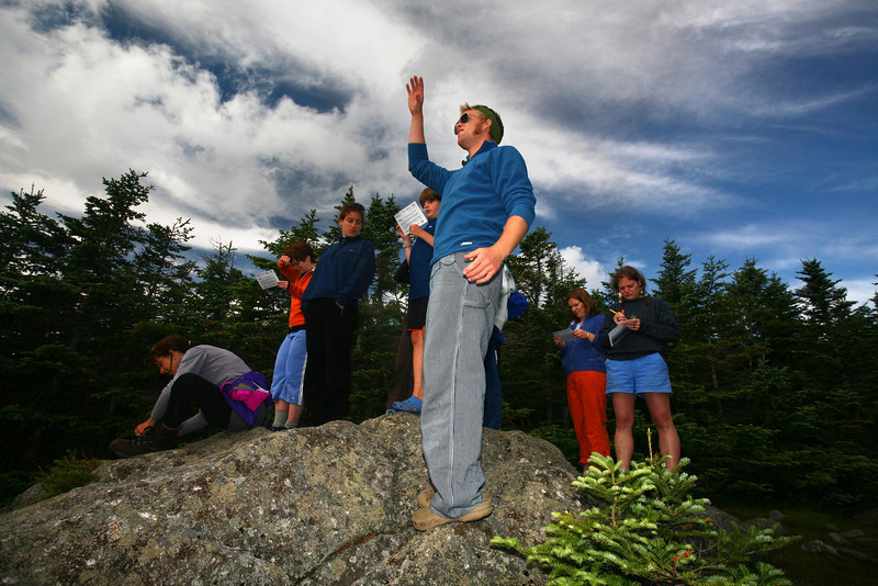 Helon Hoffer talks about the environmental impact of acid rain in the White Mountains to hut guests.