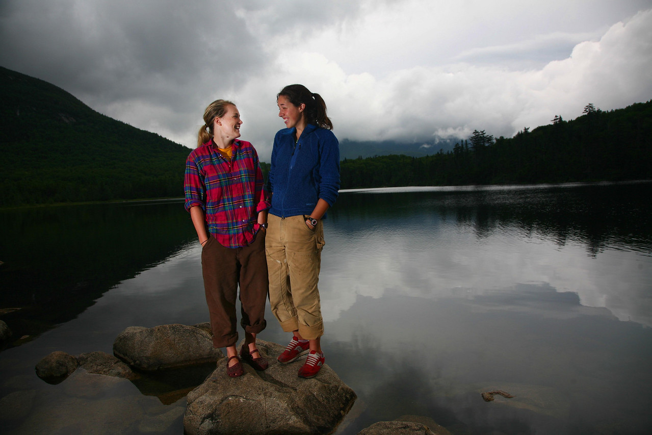 Carrie Piper and Eliza O'Neal, both hut crew members, share a lighter moment at Lonesome Lake, deep in the White Mountains.