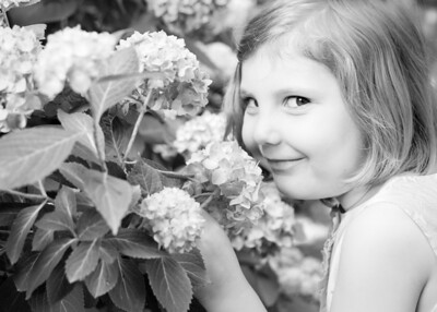 Sophia sniffing flowers crop bw (1 of 1)