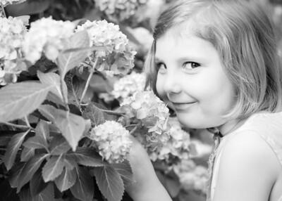 Sophia sniffing flowers  (1 of 1)