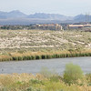 Lake Las Vegas in the distance on telephoto.  None of this water goes into Lake Las Vegas.  It goes through pipes under the lake and out the other side.