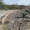 They've made a few of these desert gardens with walls.  The bike path and hiking trail is to the right.