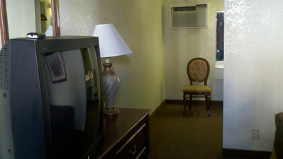 Hotel room.  Notice the weird placement of the chair? Yeah.  I couldn't reach the AC controls without it.  Story of my life.